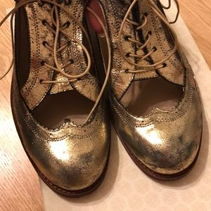 Gold distressed cut out Oxford shoes